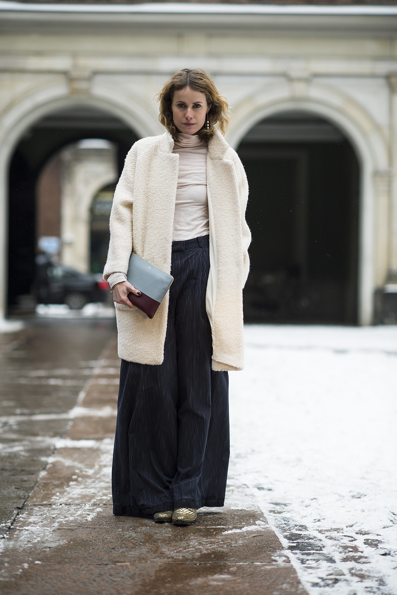 Wide-leg pants further the vintage flair of a fuzzy coat. Source: Le 21ème | Adam Katz Sinding