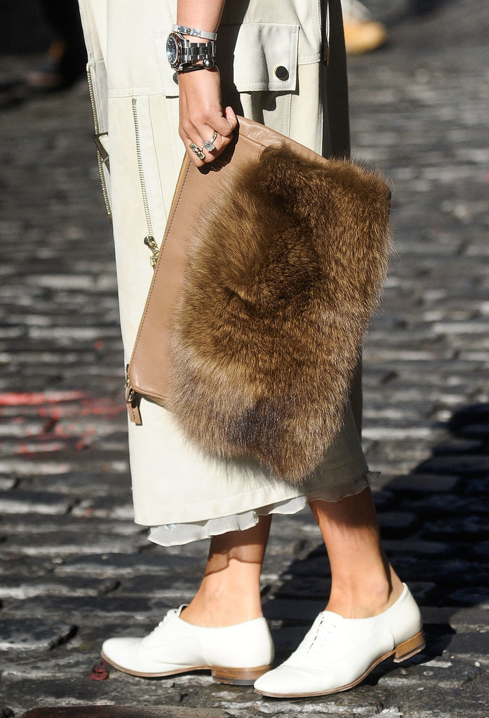 Nasiba Adilova toted a furry covered clutch.