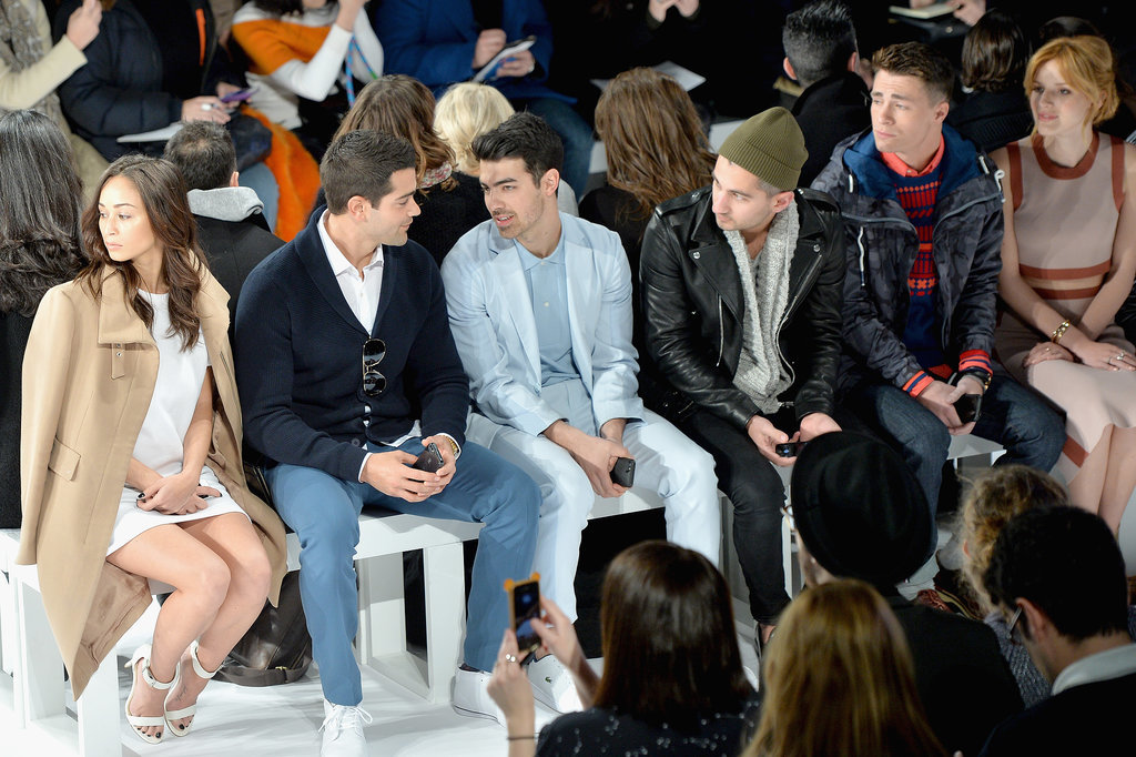 Joe sat next to Jesse Metcalfe at the Lacoste show on Saturday.