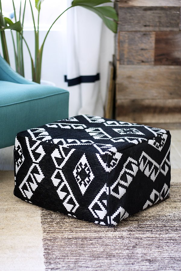 Because they're incredibly versatile, poufs are essential in small spaces. They let you kick up your heels, serve as a coffee table, or offer extra seating. But they're usually so expensive! Not the case with this ottoman DIY that uses fabric and an Ikea cube . . . and costs only $40.  Source: Kristi Murphy