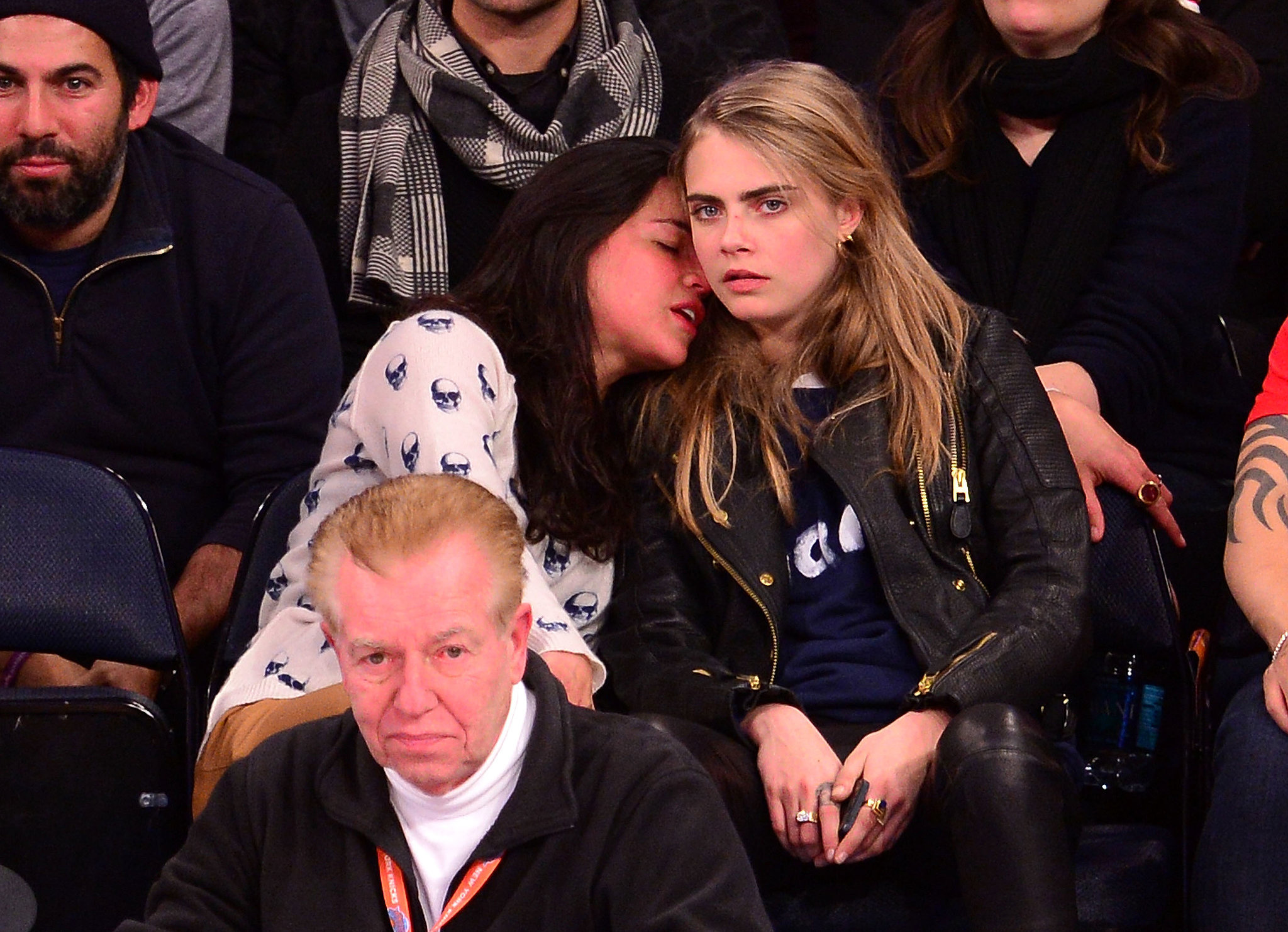 Michelle Rodriguez snuggled with Cara Delevingne at a Knicks game in NYC.
