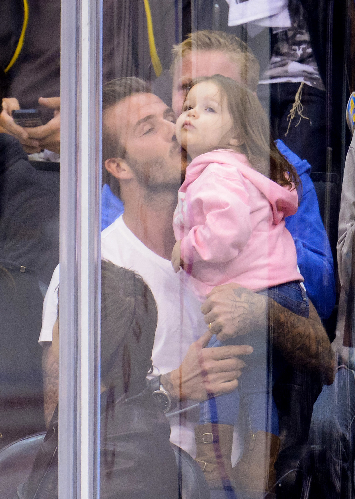 David Beckham gave Harper a kiss when they were put on the Kiss Cam at a Kings hockey game in LA.
