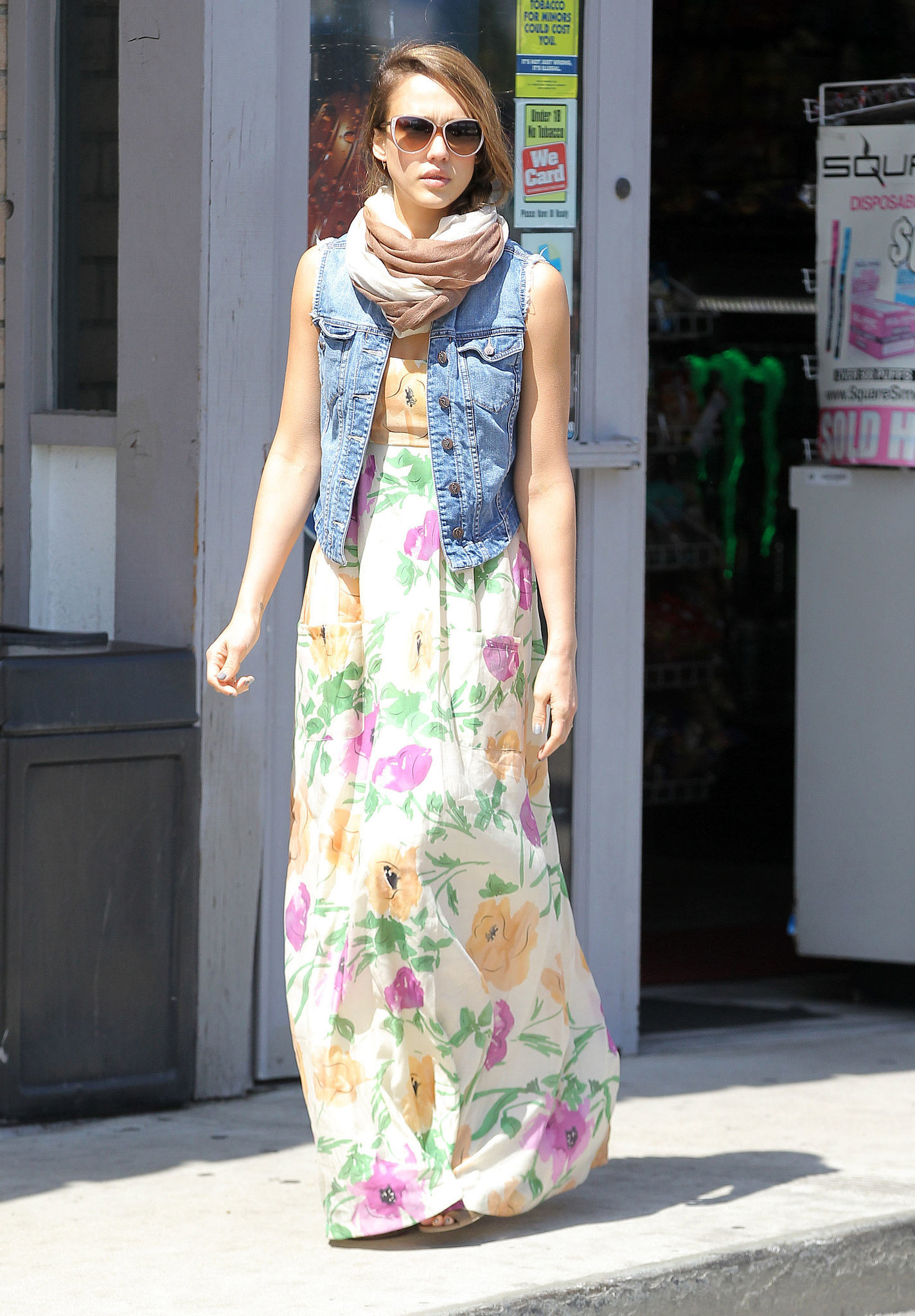 Jessica exuded Spring in a floral Karen Zambos maxi, a denim Genetic Denim vest, and a two-toned wrap scarf in LA.