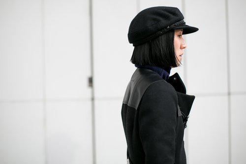 Eva Chen topped off her look with a newsboy cap.