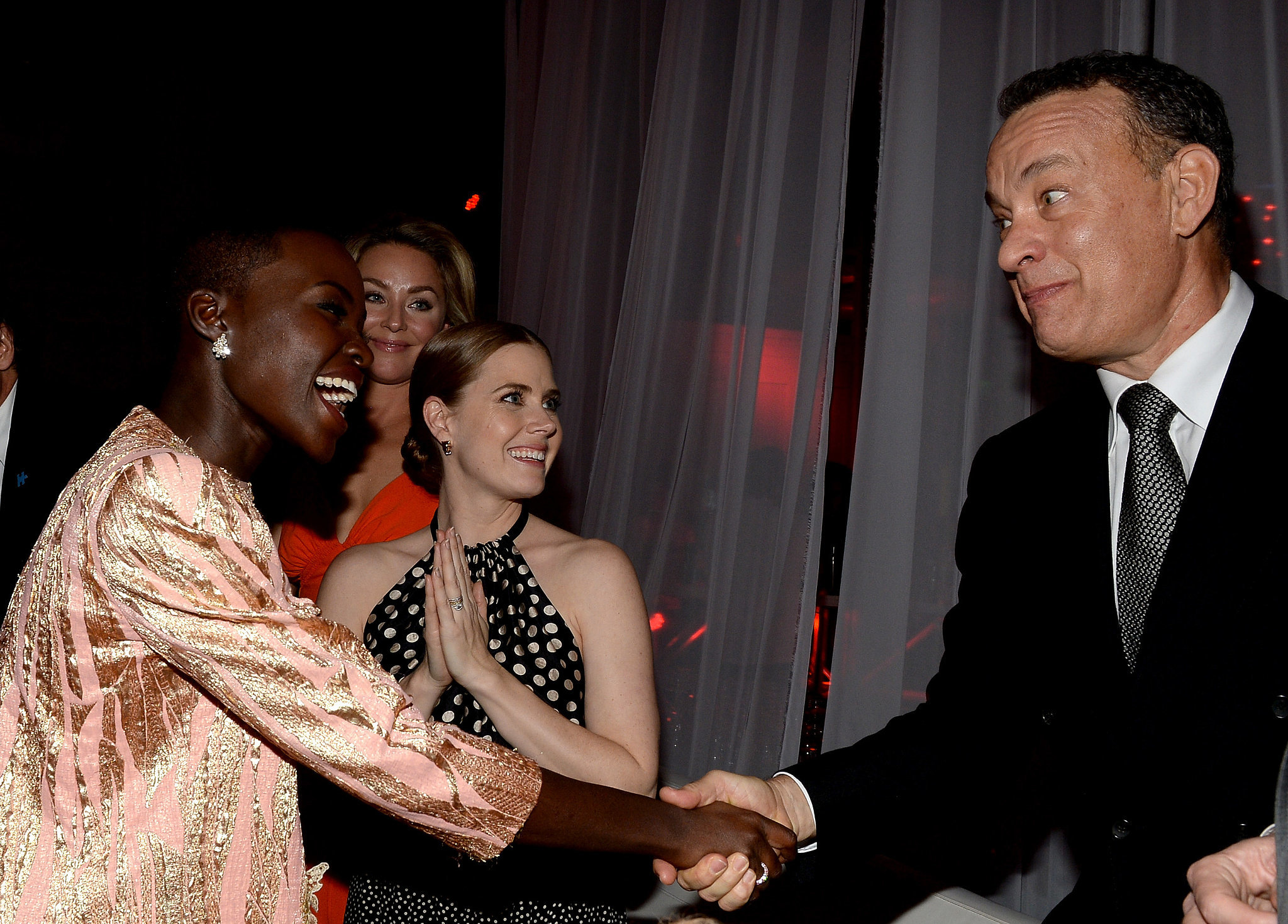 Lupita had the attention of Tom Hanks at the Palm Springs Film Festival.