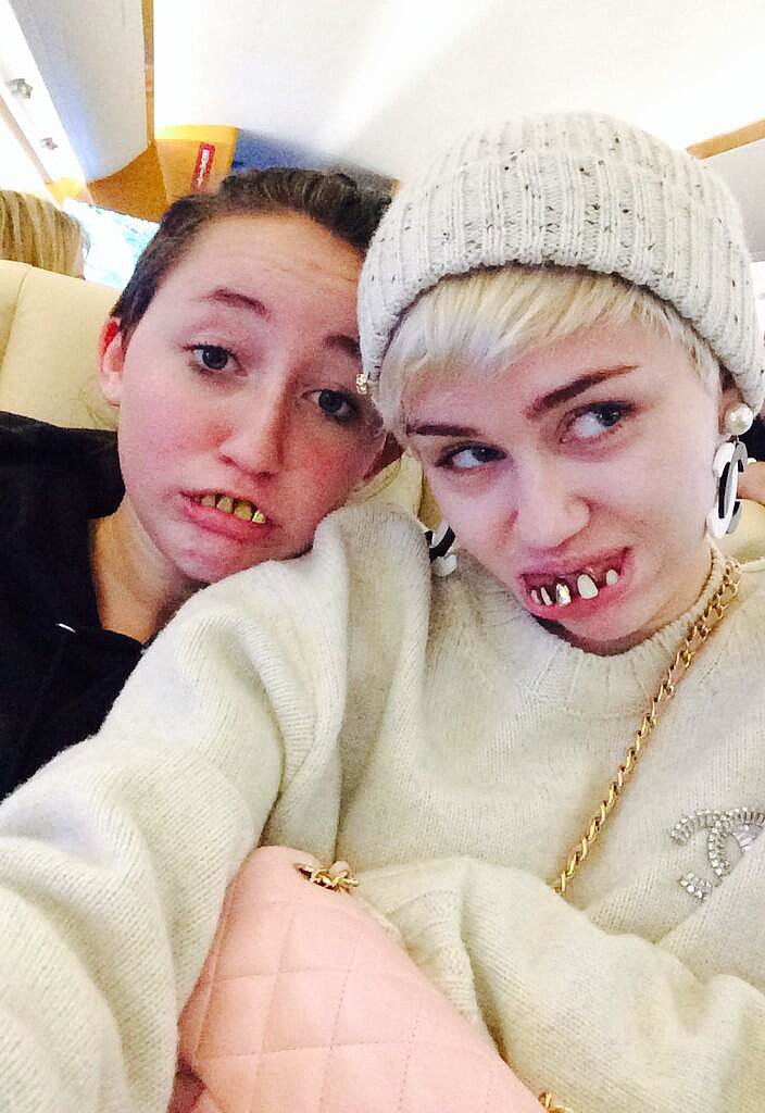 Miley Cyrus and her sister Noah rocked wacky teeth. Source: Twitter user mileycyrus