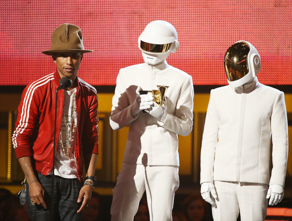 Grammys night was one to remember for Pharrell and his hat. The couple joined Daft Punk to accept an award.
