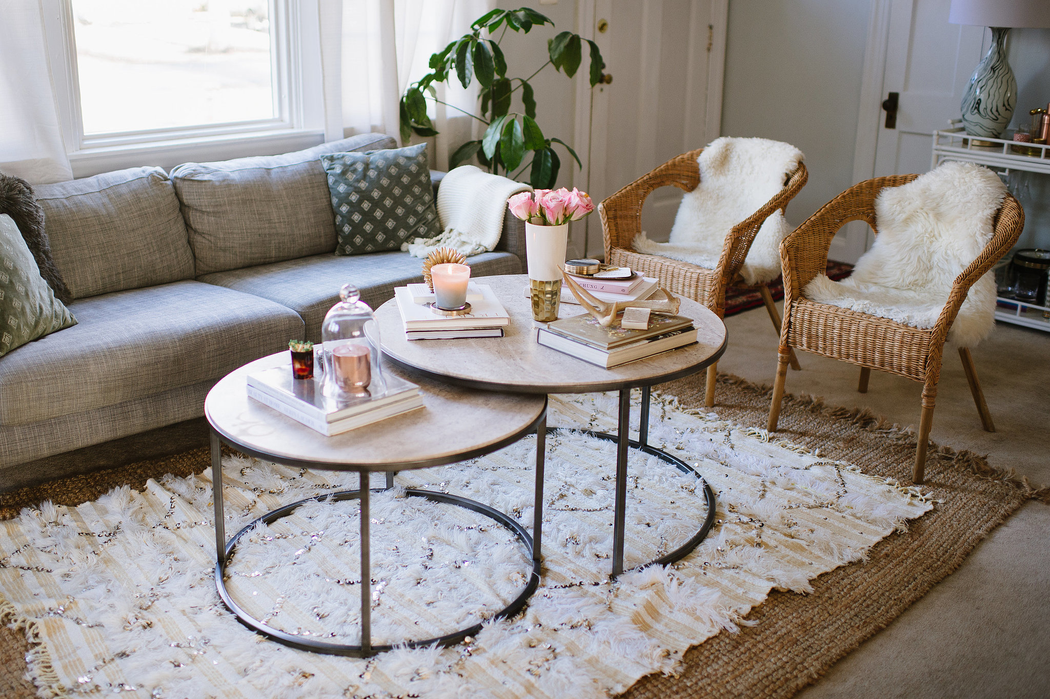 Carpet in a home or rental can be challenging, but layering rugs is a great solution.  Source: Natalie Franke