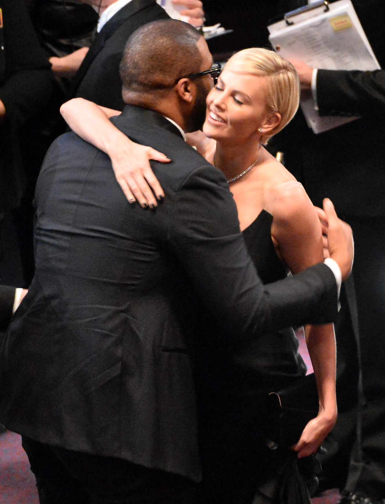 Charlize Theron gave Steve McQueen a big hug.