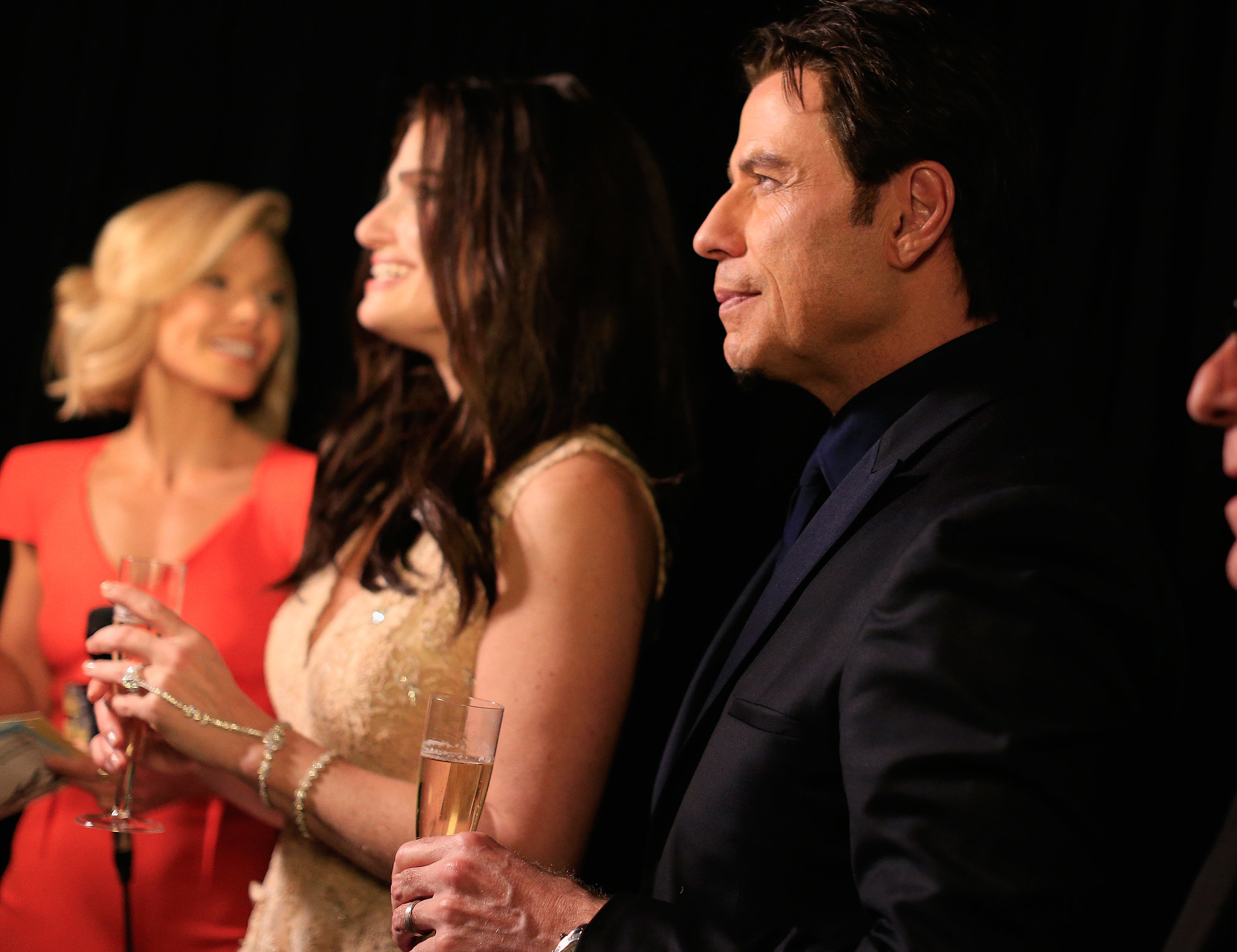John Travolta and Idina Menzel sipped some bubbly backstage.