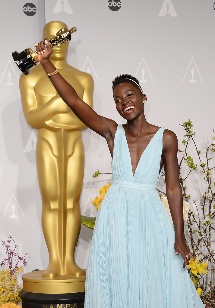 Nyong'o thrust her award proudly in the air.