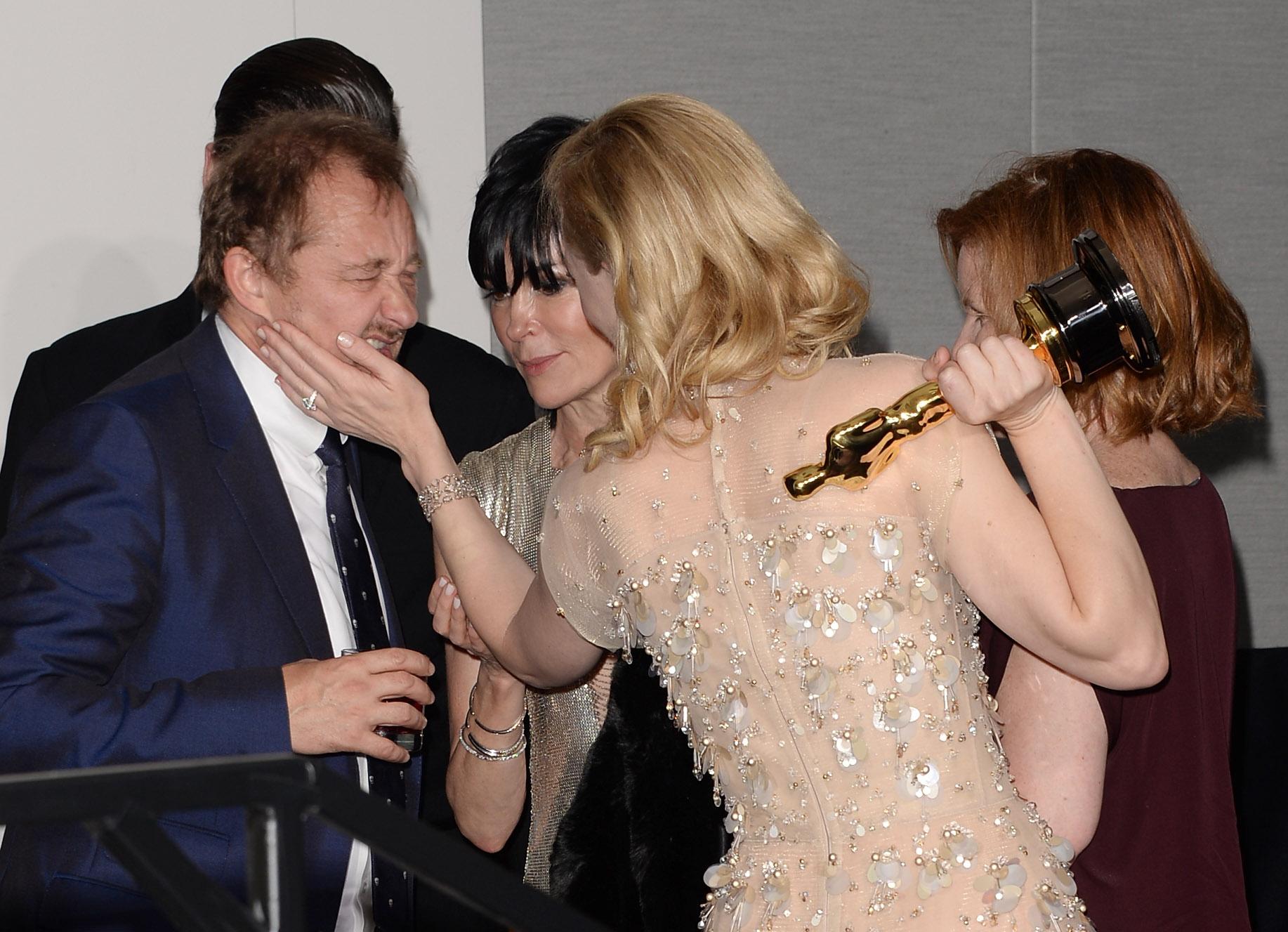 Blanchett stroked her husband Andrew Upton's cheek.