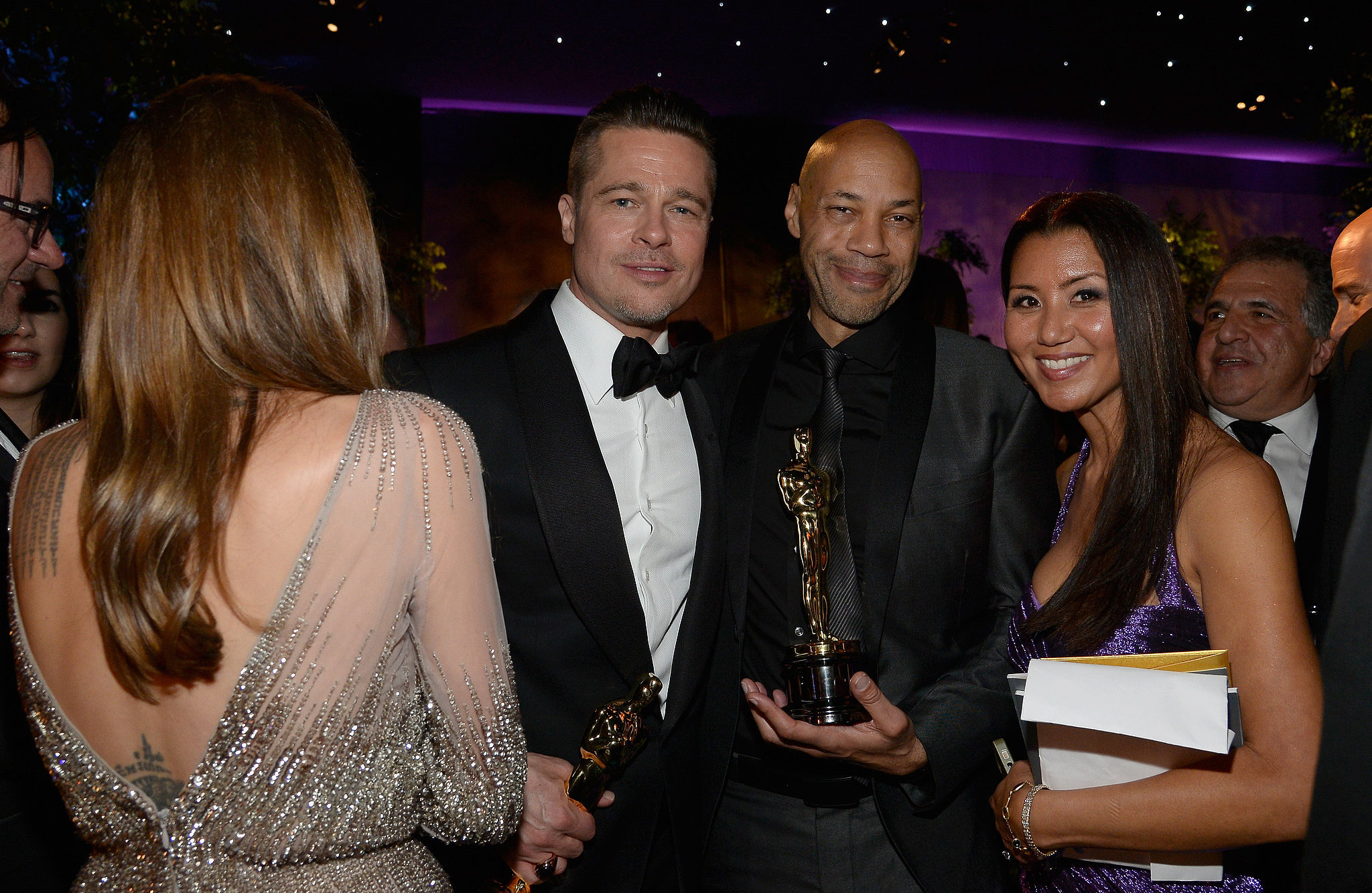 Brad Pitt mingled with 12 Years a Slave screenwriter John Ridley and Gayle Ridley.