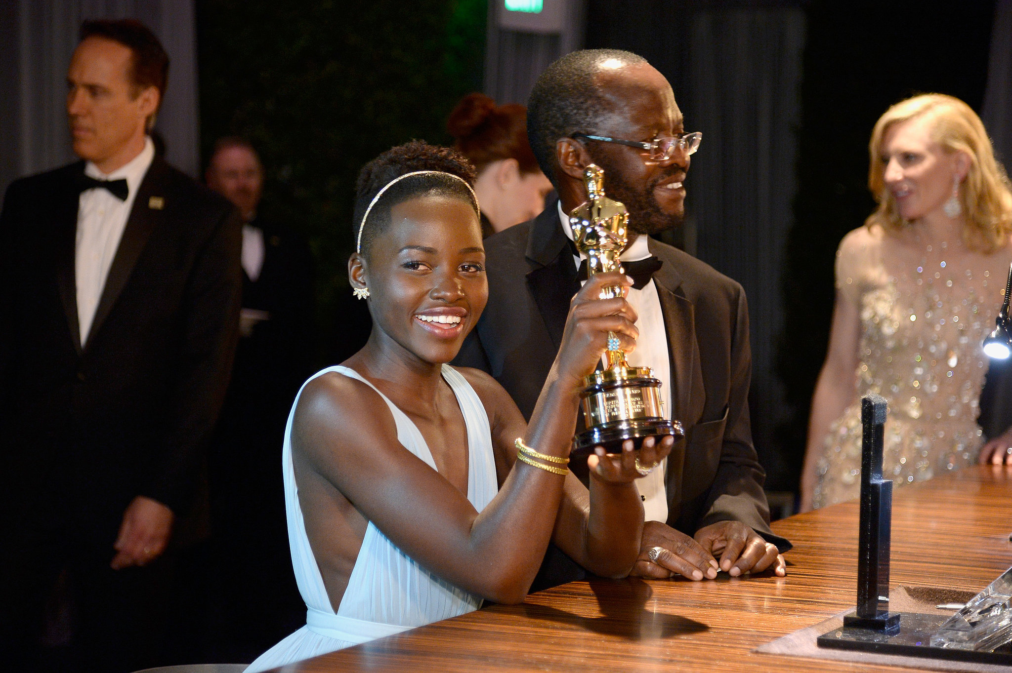 Lupita Nyong'o showed off her engraved Oscar.