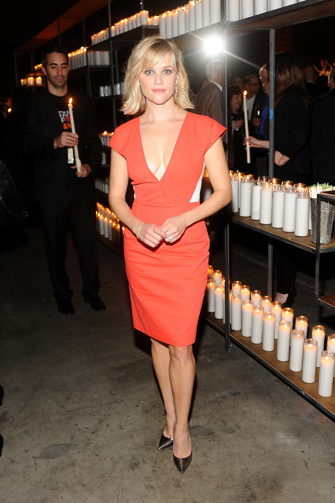 At a Hollywood Stands Up to Cancer event, a basic orange sheath had plenty of sizzle thanks to a low neckline.