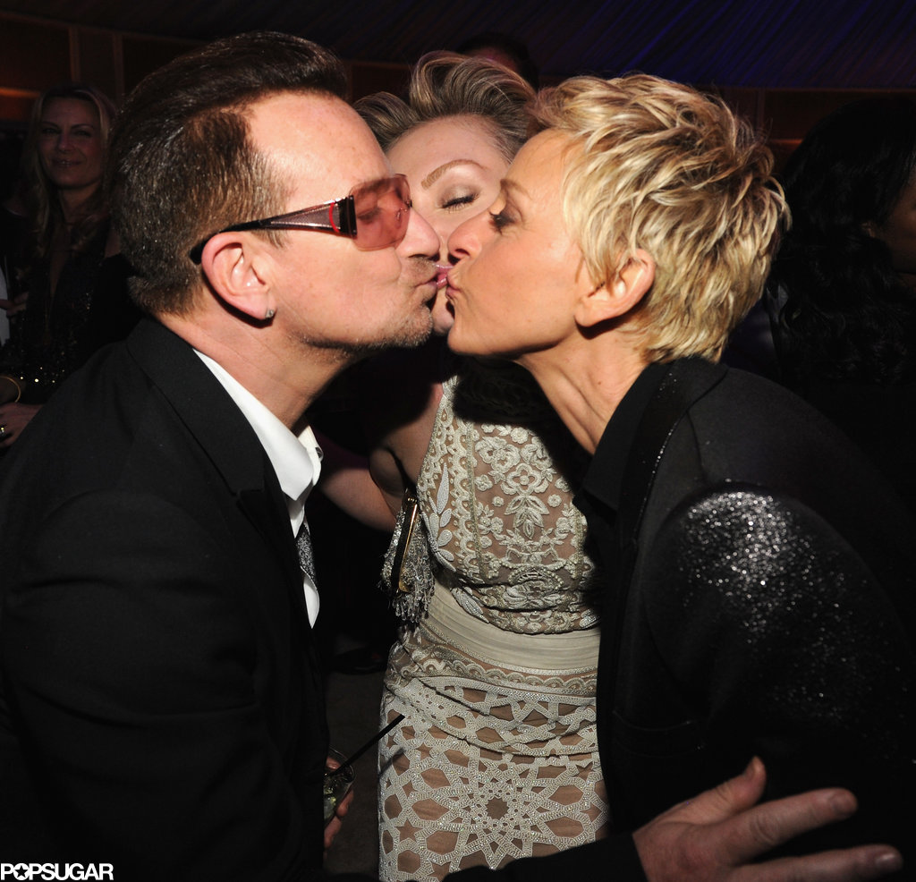 Bono, Portia de Rossi, and Ellen DeGeneres went in for a three-way kiss at the Vanity Fair Oscars party.