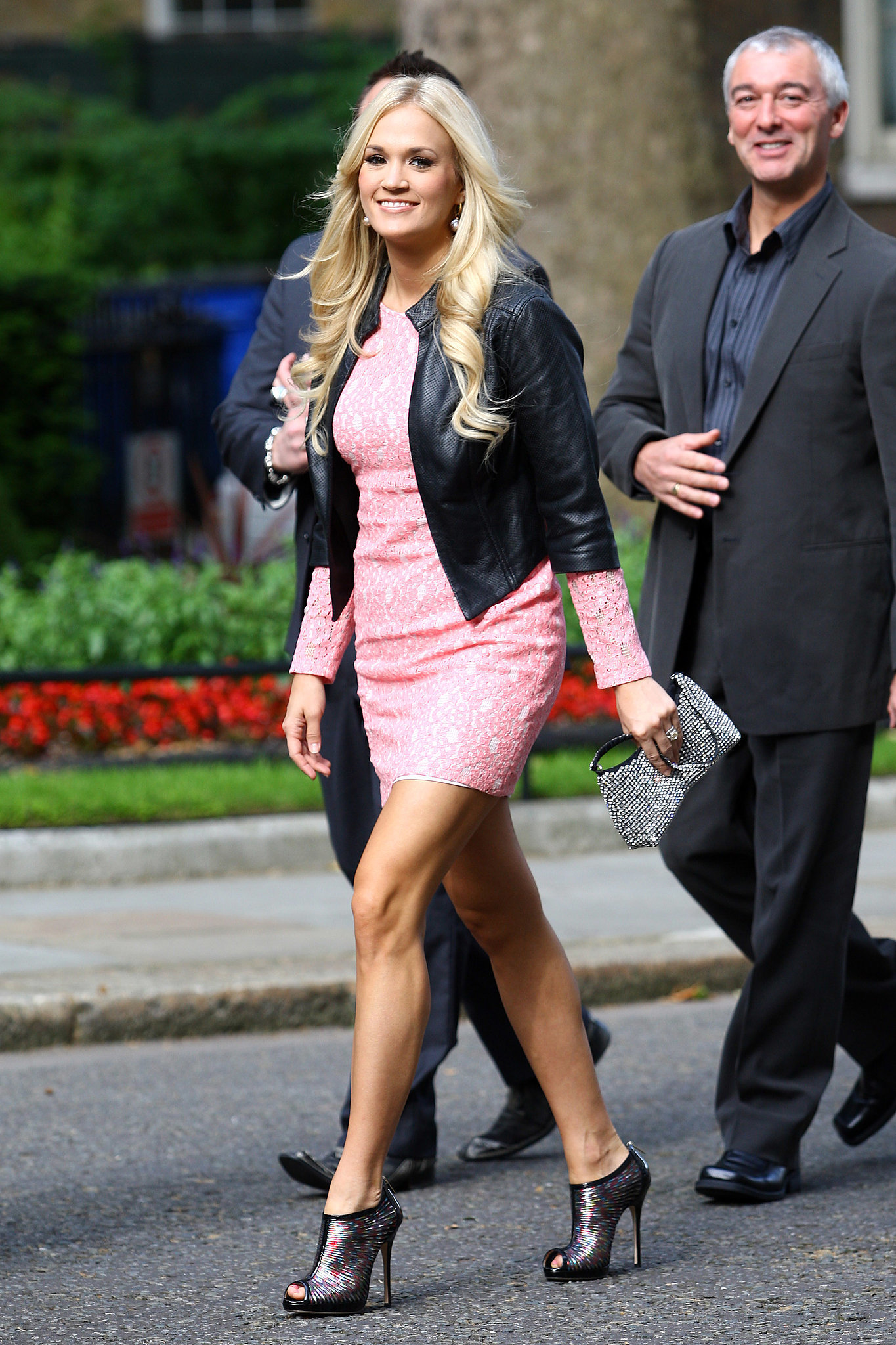 During a June 2012 London excursion, Carrie toughened up her lace confection with a cropped black leather jacket and psychedelic Jimmy Choo booties.