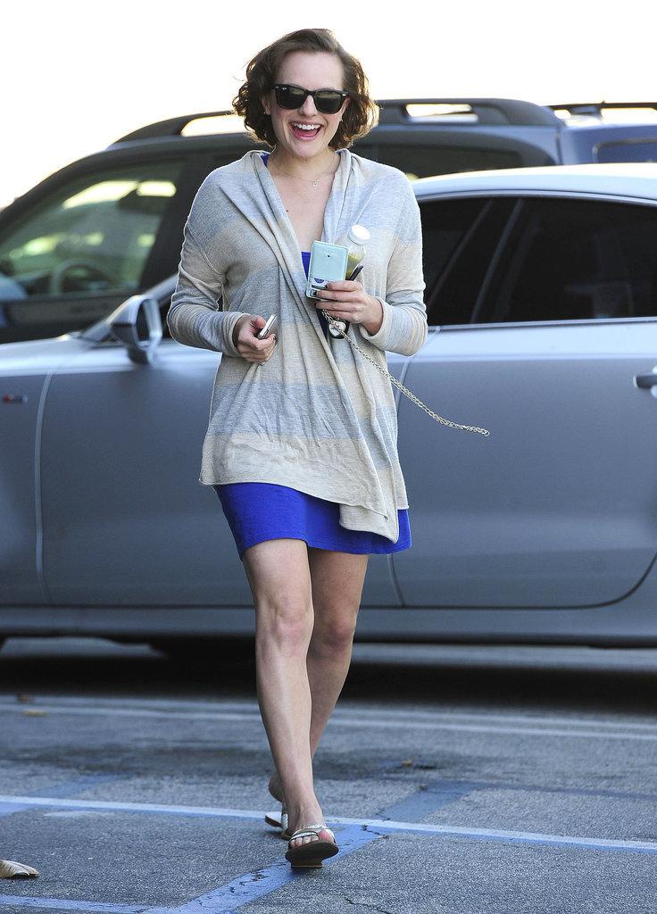 Elisabeth Moss flashed a huge smile on Thursday when she ran errands in West Hollywood.