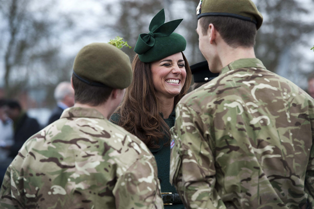 Kate Middleton had a good laugh as she participated in an annual St. Patrick's Day tradition of visiting the Irish Guards in Aldershot, England.