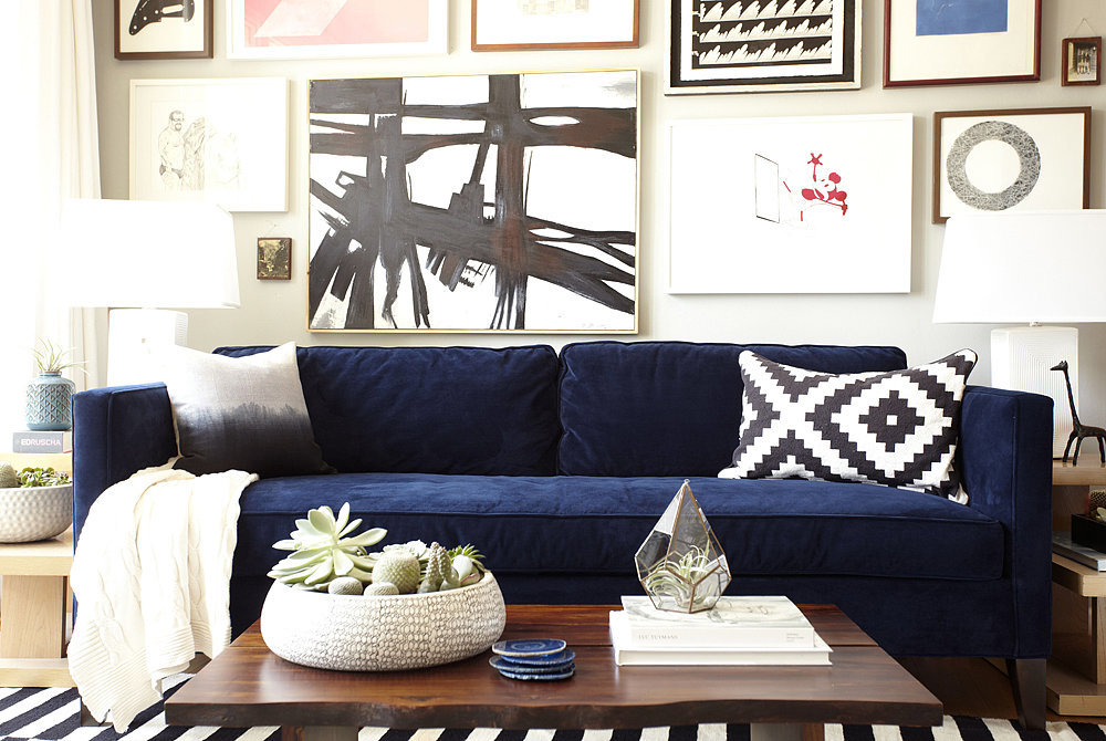 Choosing a solid sofa works as the base for an eclectic mix of patterns and textures.  Photo by Zeke Ruelas via Homepolish