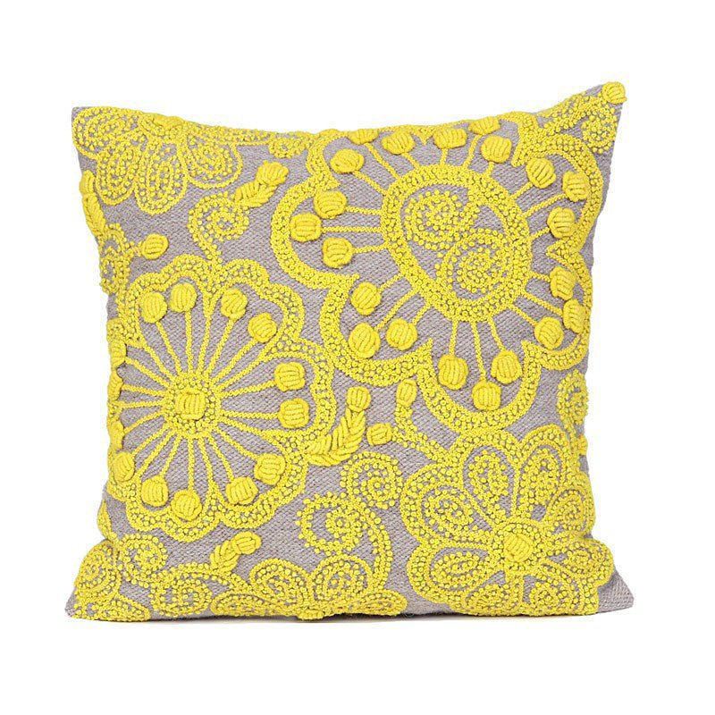 This handwoven pillow ($96) will bring a pop of color to an eclectic space.