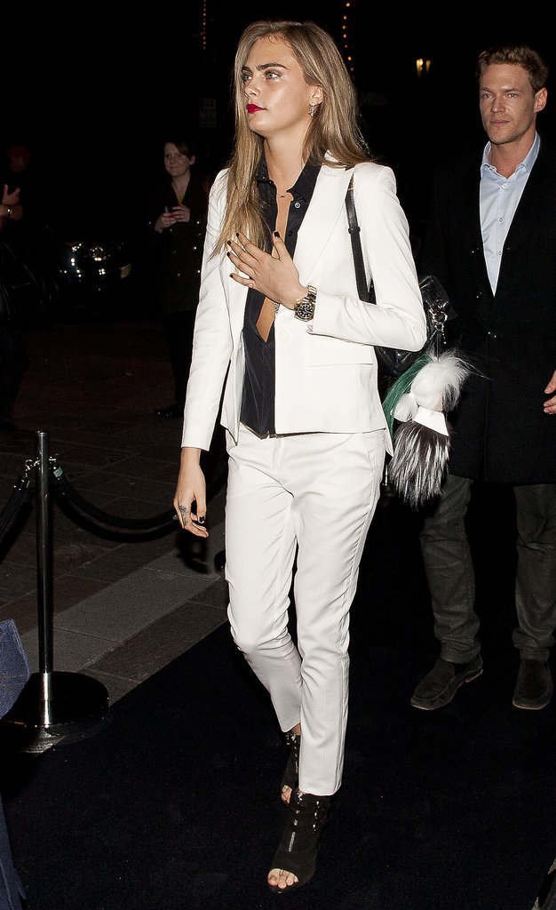 For a night out in London, Cara Delevingne skipped the cocktail dress in favor of a very sexy white suit.