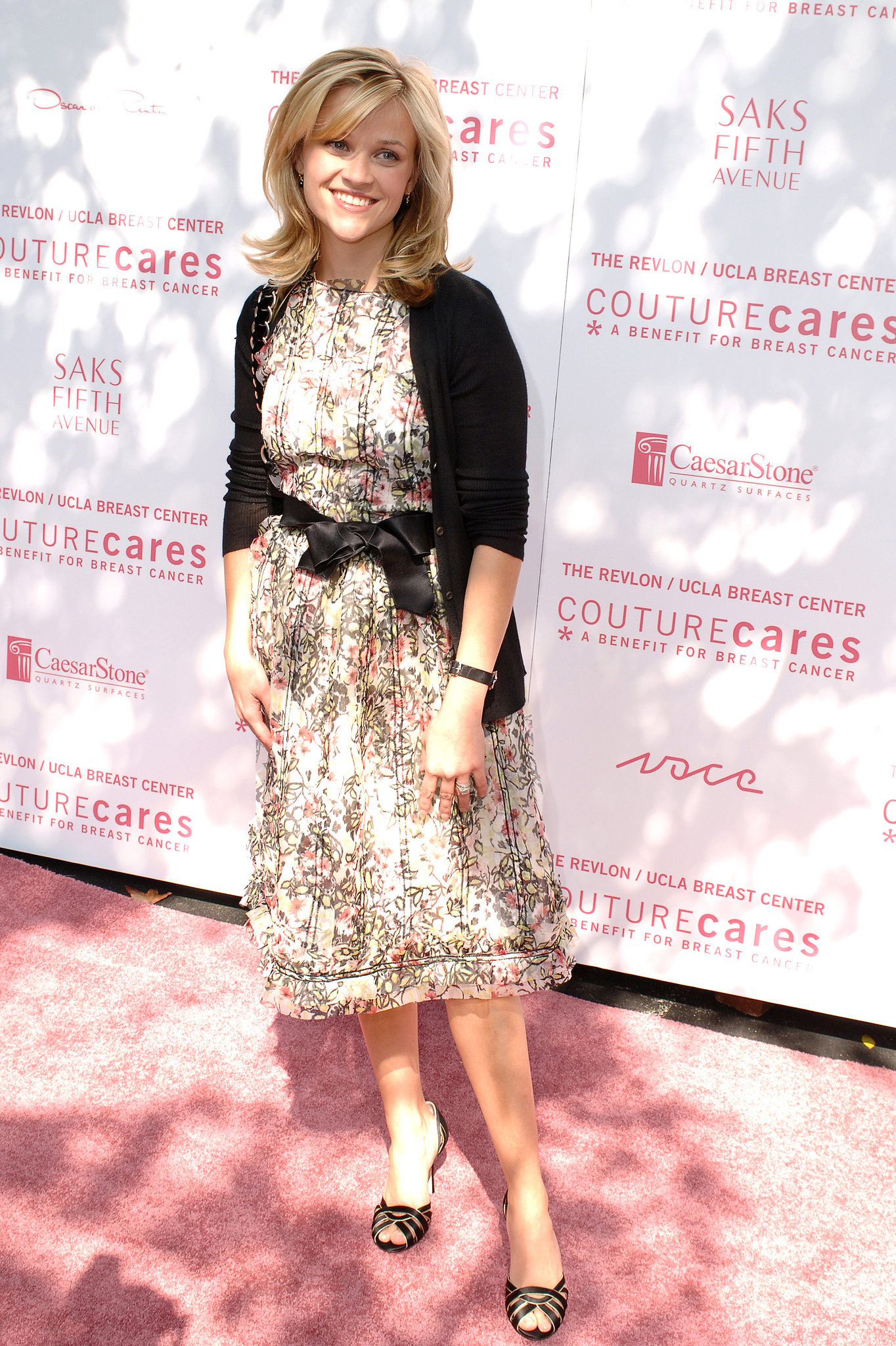 Reese Witherspoon in Floral Dress and Black Cardigan