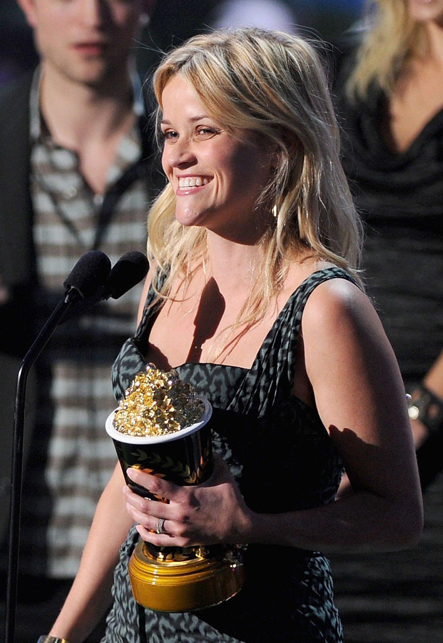 Reese was beaming while accepting her award at the MTV Movie Awards in June 2011.