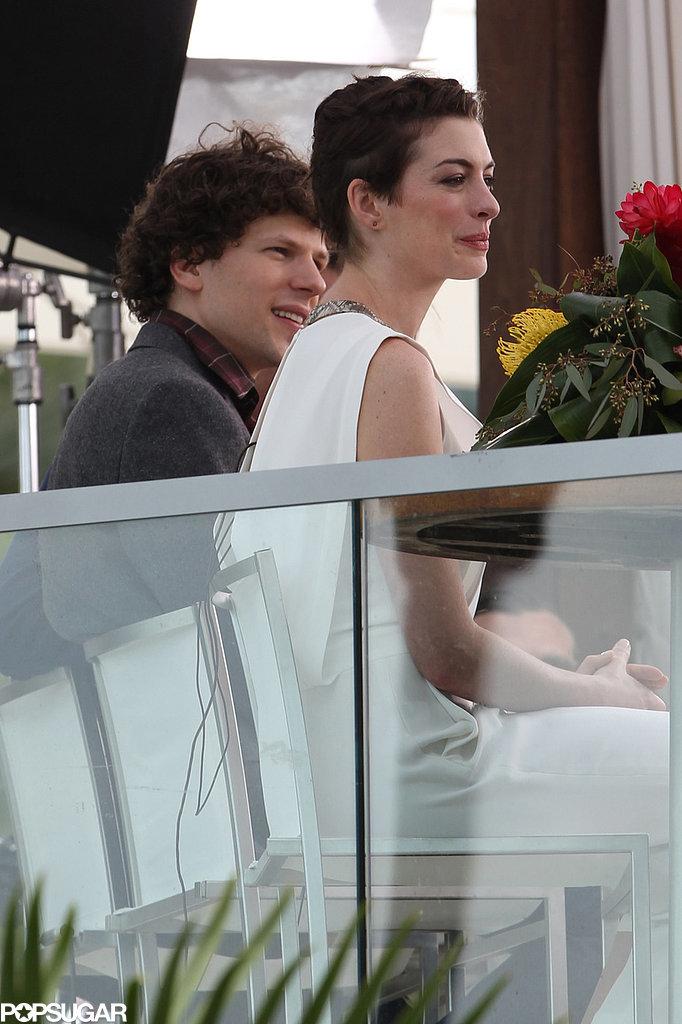 She sat with costar Jesse Eisenberg.