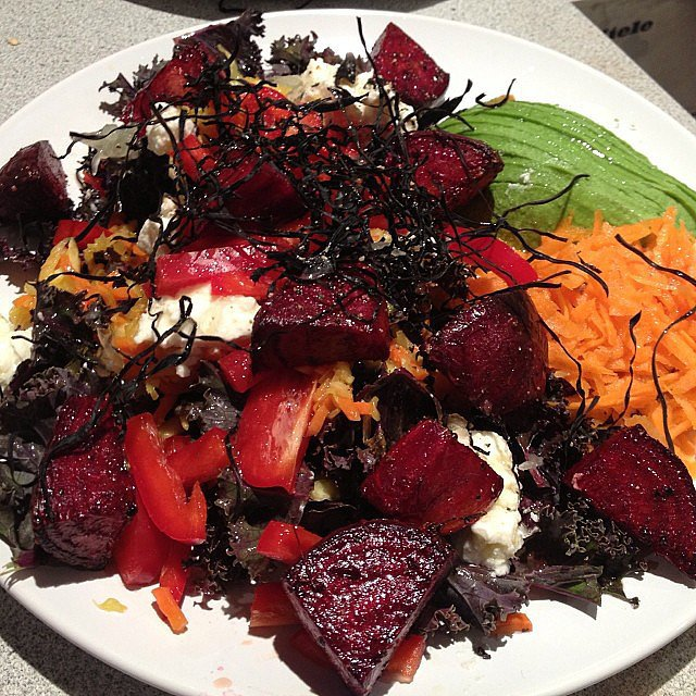 And when she's not at work, she's at home making one of her healthy salad creations like this one made with kale, pickled vegetables, roasted beets, marinated goat feta, peppers, sea vegetable chips, red onions, carrot, avocado and lemon juice. Yum! Source: Instagram user nictrunfio