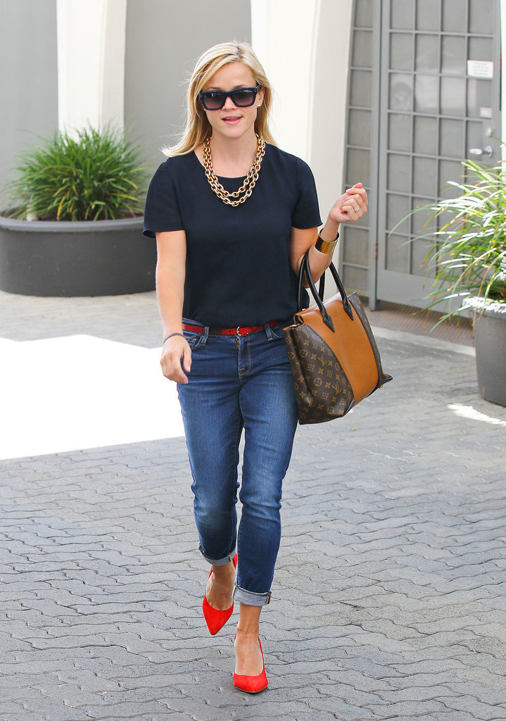 Reese Witherspoon in Red Pumps and Louis Vuitton Bag