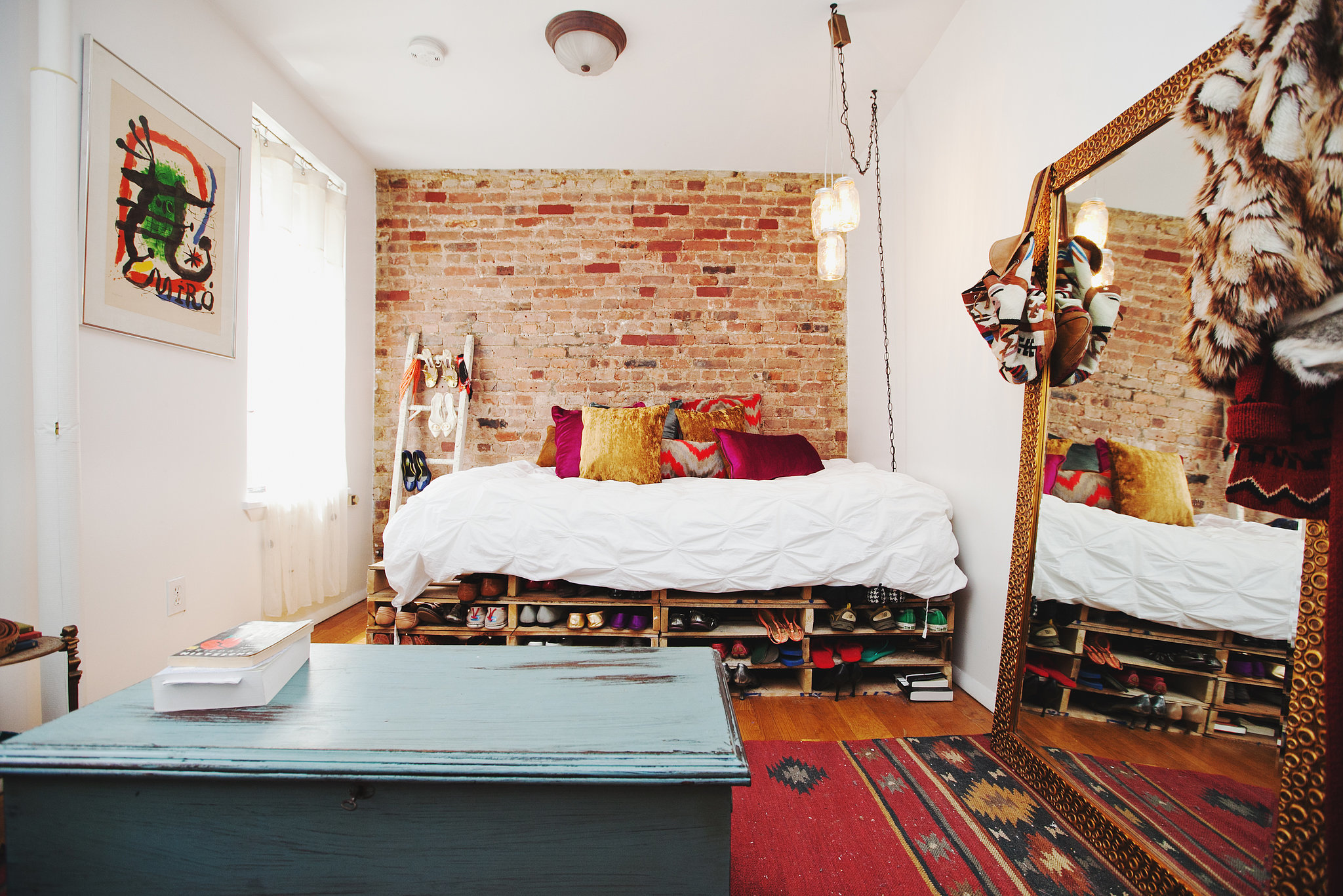 Now light and bright, this city studio has an eclectic, California vibe.  Photo by Chellise Michael via Homepolish