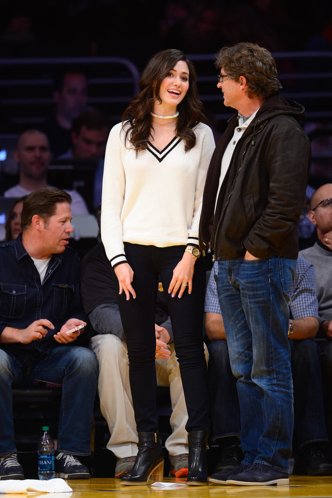 Emmy Rossum went for the athletic vibe (albeit a more classic Americana one) at the Staples Center, picking a varsity sweater, black jeans, ankle boots, and a candy necklace.