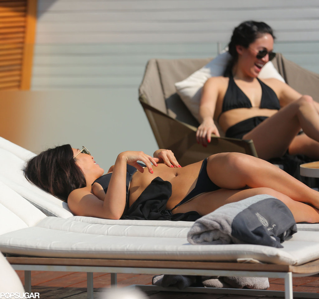 Kim Kardashian Barely Covers Her Backside in a Sexy Black Bikini