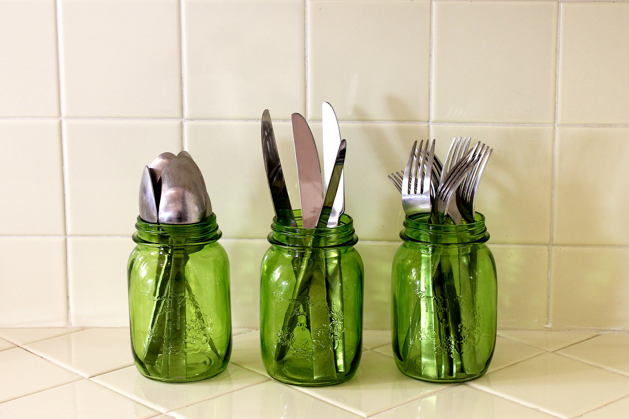 Another great tip from Emily: don't be afraid to invade your parents' garage — that's where she got all her silverware. The green mason jars? Those were a thoughtful gift.