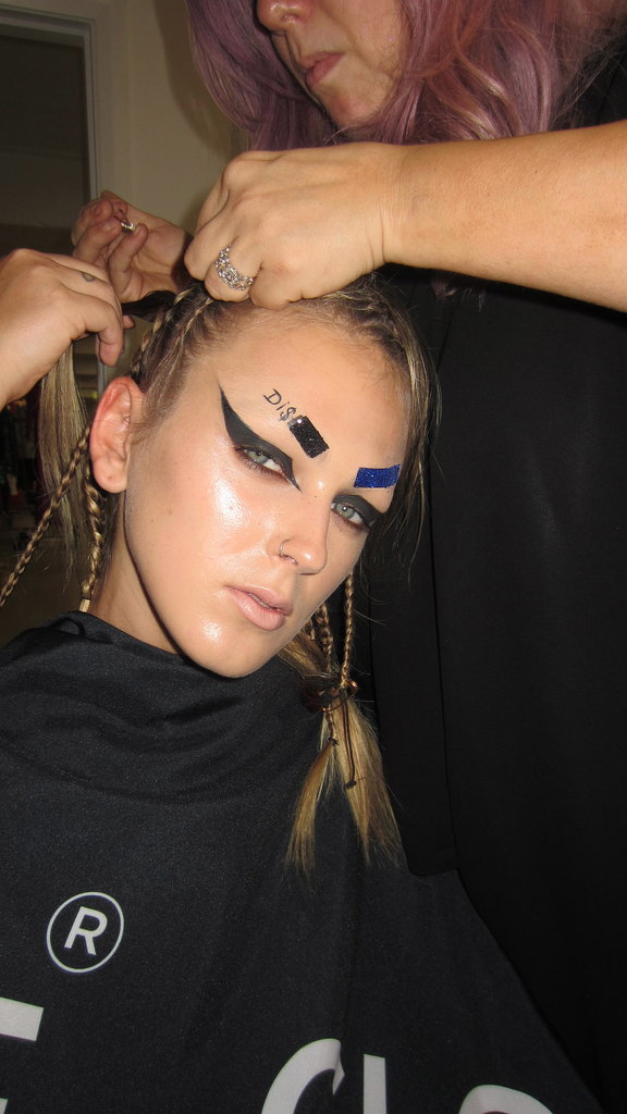 """Liner-wise, """"we used Mac Cosmetics Black Track Fluidline to create the full, fierce cat liner. You need a thin brush and start by lining your top lash line first and then with your eyes open, complete the rest, looking straight ahead and using your brush to create the shape at the outer corners."""""""