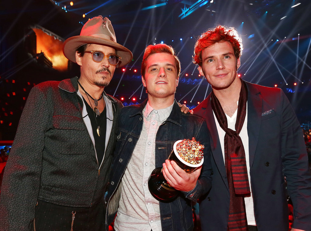 Johnny Depp hung out with Josh Hutcherson and Sam Claflin, who accepted the award for move of the year for Catching Fire.
