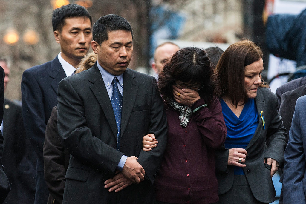 A woman became emotional during the wreath-laying ceremony on the one-year anniversary.