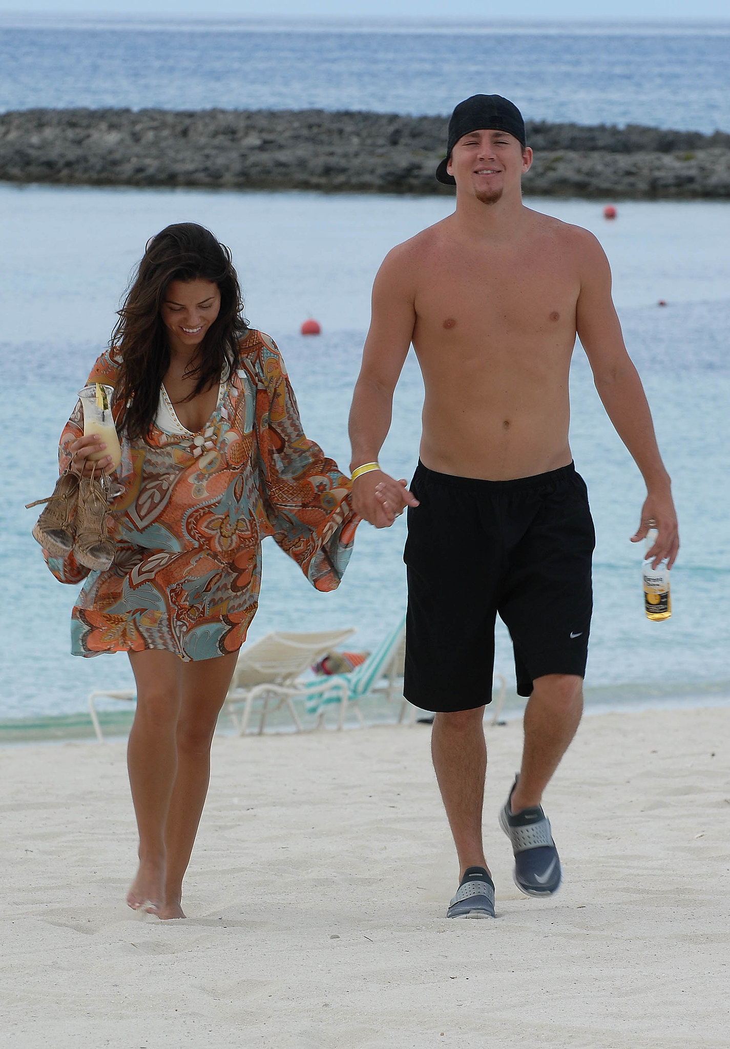Shirtless Channing held hands with Jenna during a romantic stroll along the Nassau beach in July 2007.