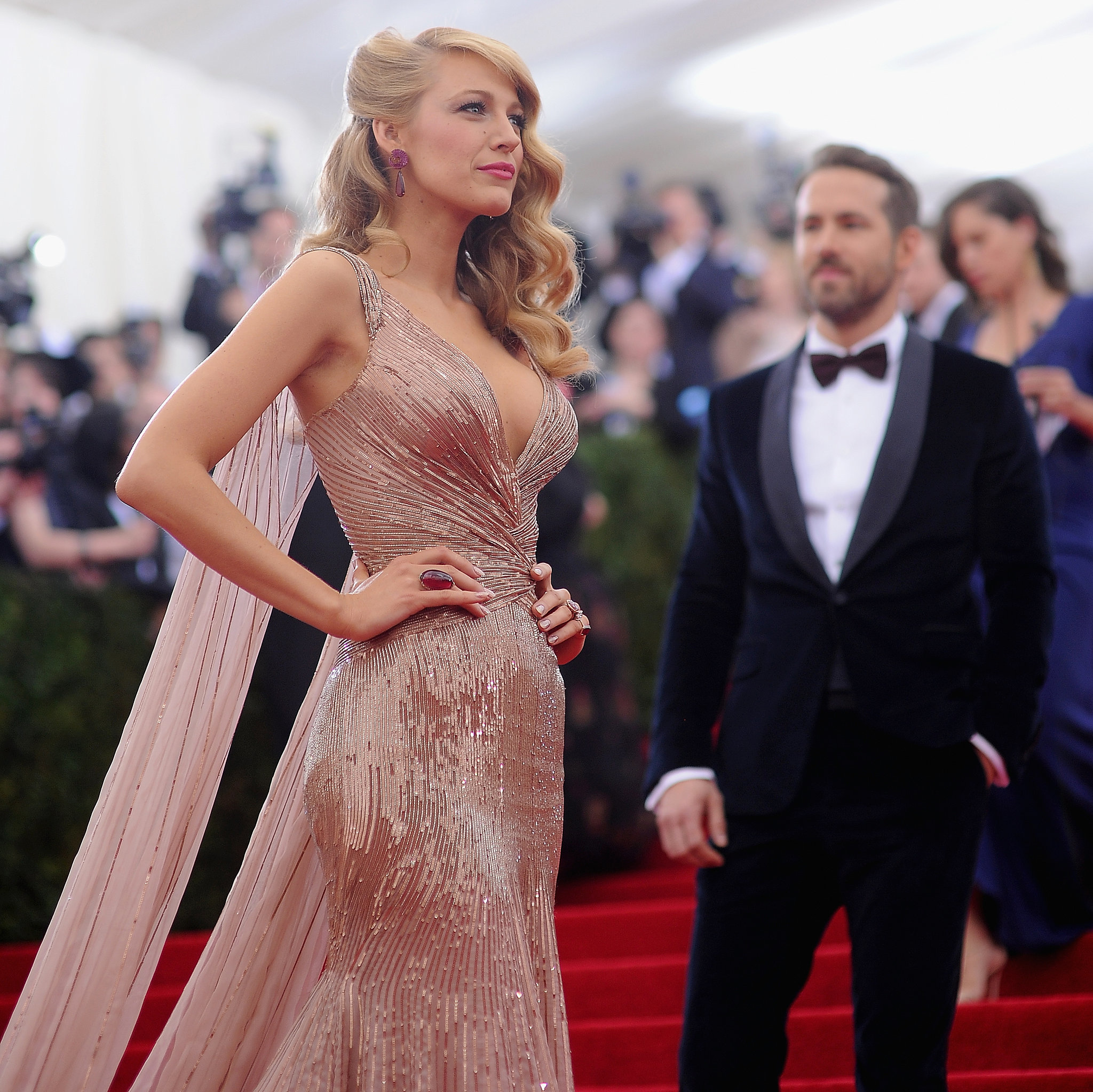 Ryan Reynolds patiently waited for his wife, Blake Lively, as the cameras flashed.