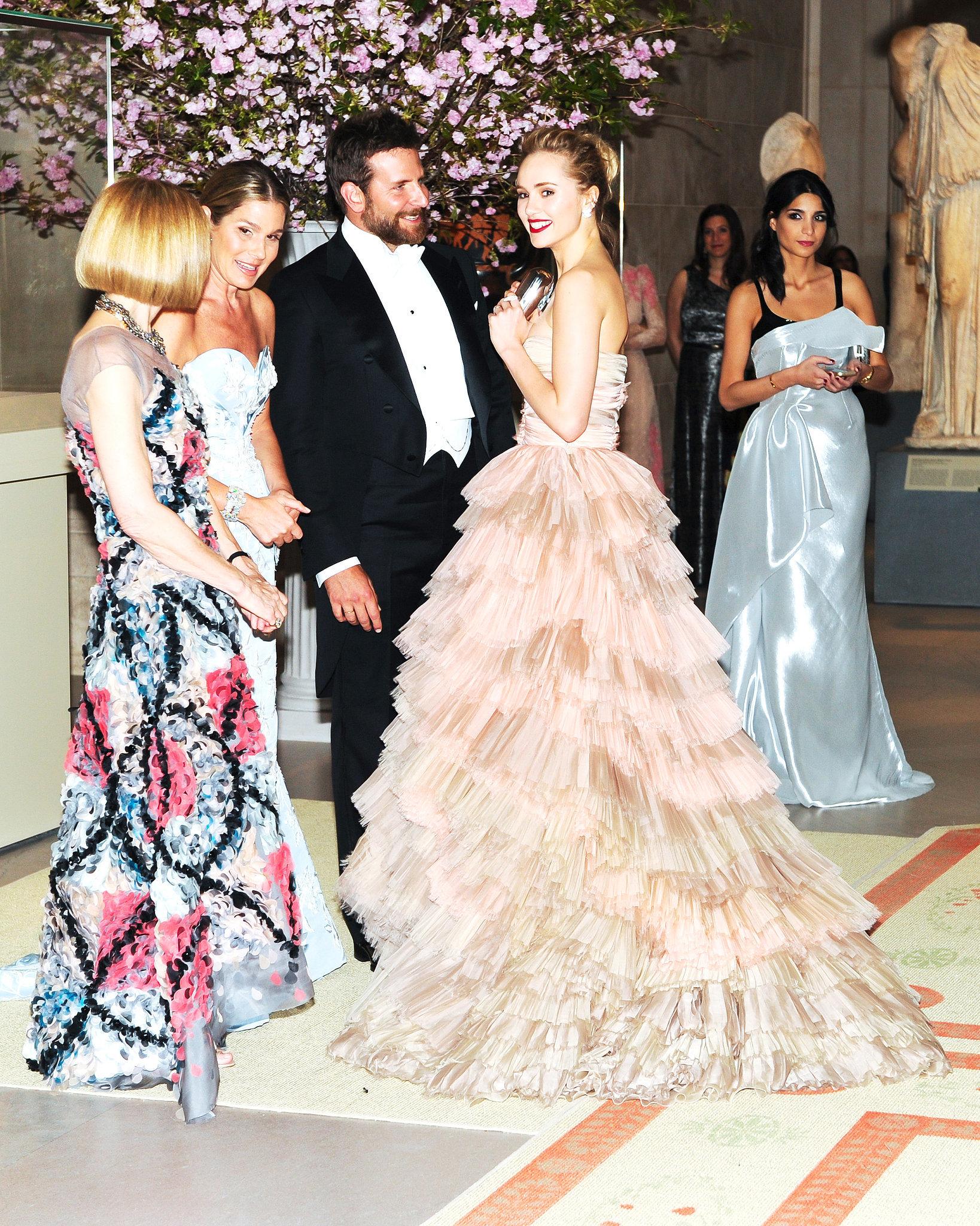 Bradley Cooper greeted girlfriend Suki Waterhouse in the receiving line.