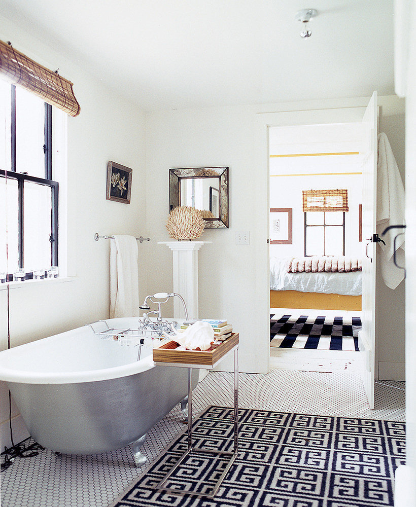 Isn't this tray table great? A similar concept to a TV dinner tray, this sleek option is perfect for bath necessities. It can also be moved around or tucked away when not in use.  Source: Domino
