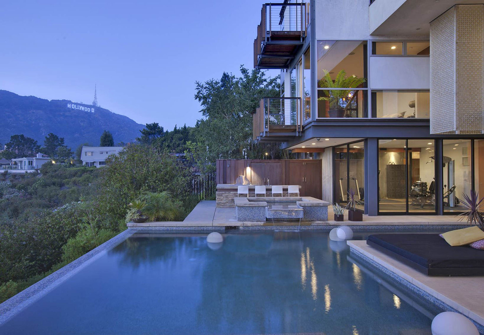 Another look at the infinity pool and the home's several balconies.  Source: Realtor.com
