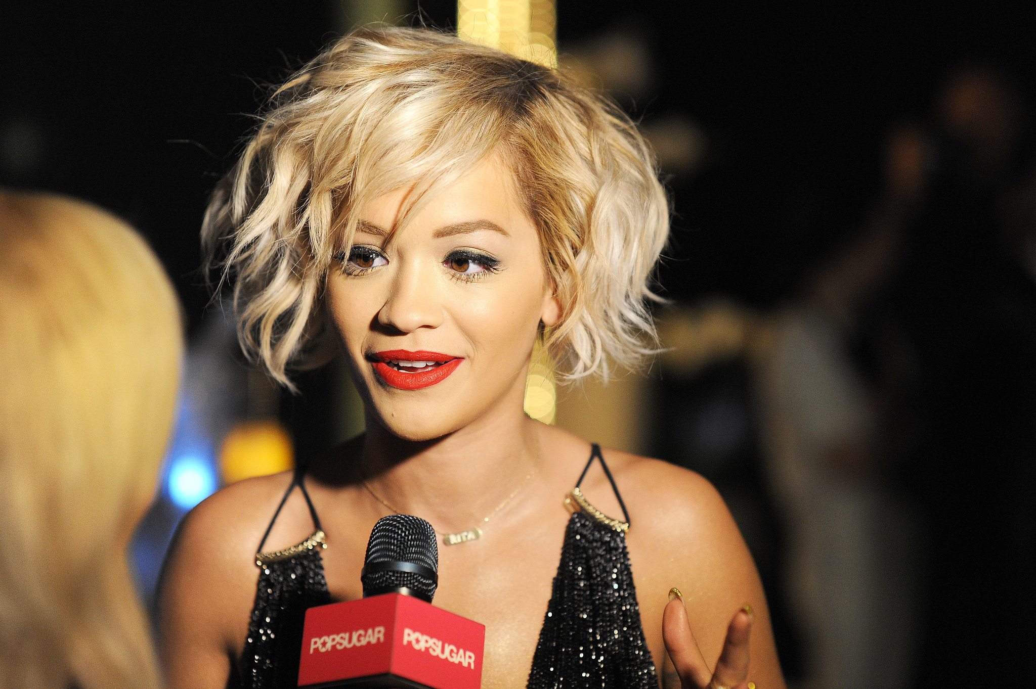 """Rita Ora Talks Fifty Shades' """"Shock Value"""" and Sings a Stripped-Down Set at Cannes"""