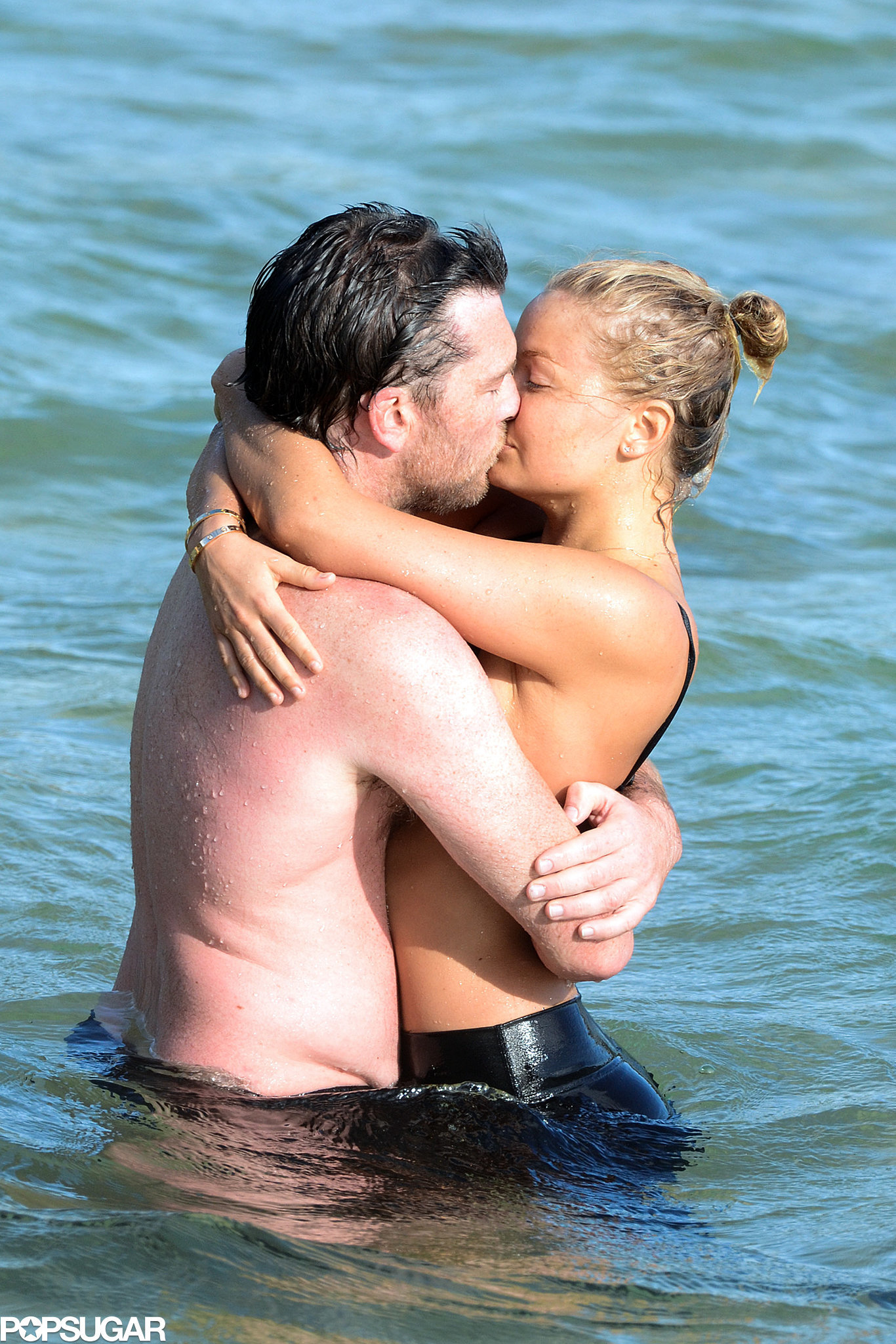Sam Worthington and Lara Bingle showed love at the beach in Sydney back in October 2013.