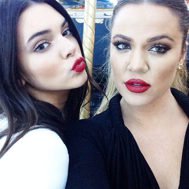 Kendall and Khloé were matching with their bright lips. Source: Instagram user khloekardashian