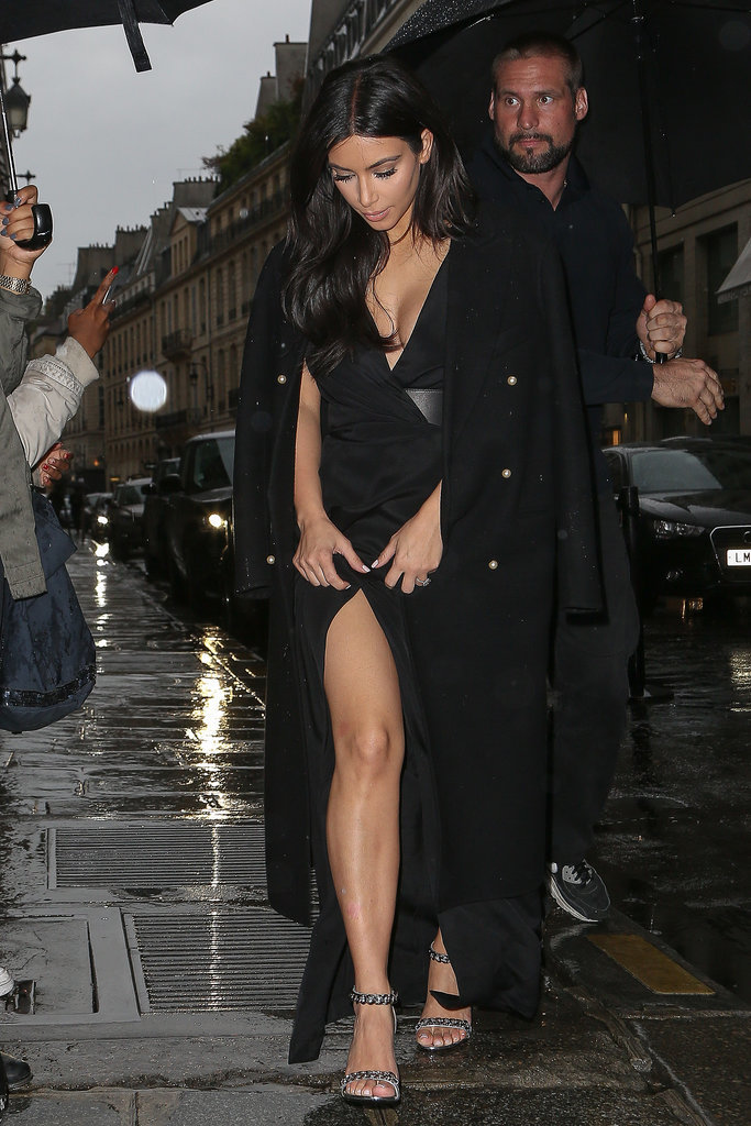 For her evening look, Kim showed a little leg but draped a long coat over her shoulders.