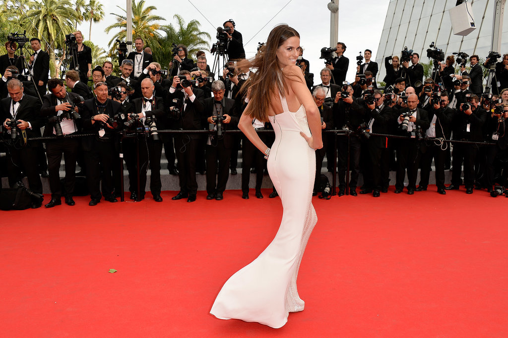 Izabel Goulart struck a pose in a fitted white gown at the Cannes premiere of The Search.