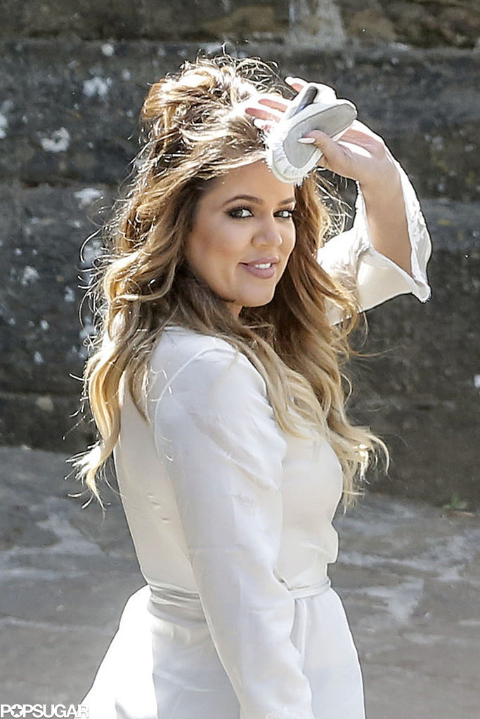 Khloé Kardashian wore a white robe before the wedding.