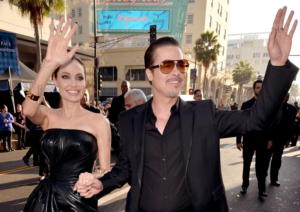 "Angelina Jolie had the loving support of her fiancé, Brad Pitt, at the premiere of Maleficent in LA, where Brad was attacked on the carpet by Ukrainian ""prankster"" Vitalii Sediuk."